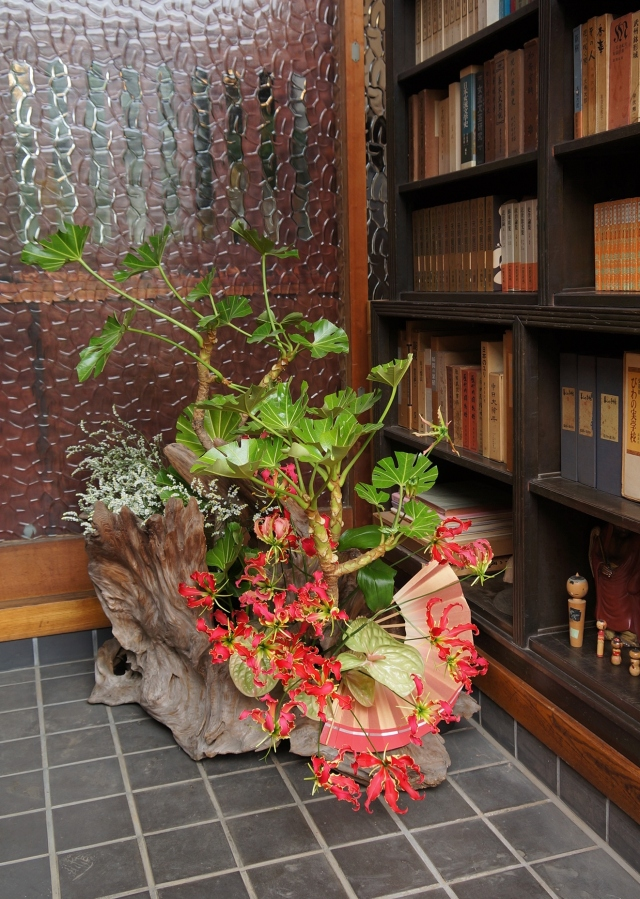 Installation in the entryway- my composition using driftwood, gloriosa lily, yatsude branch, anthurium, baby's breath.