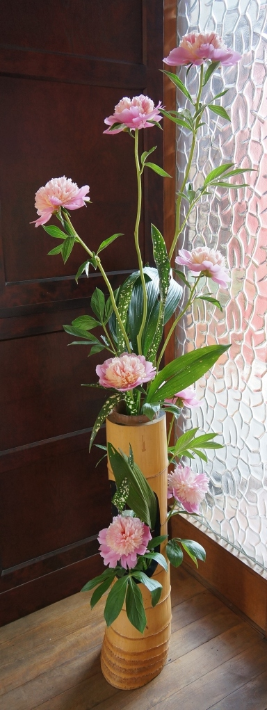 My composition with peony and aspidistra in a vintage bamboo vase